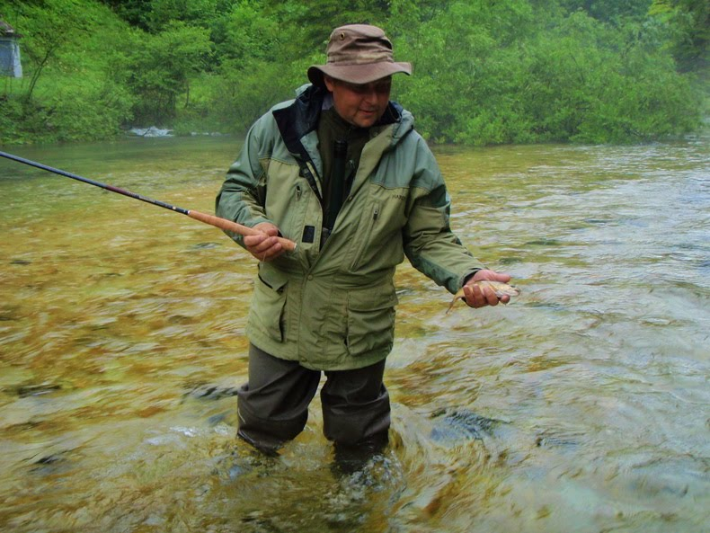 Wojtek Gibinski with wild trout high up the Radovna